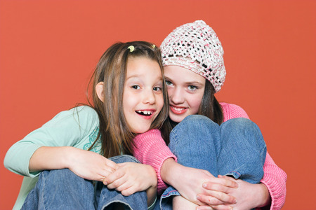 Two young girls smiling