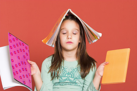 Young girl meditating with school notebooks