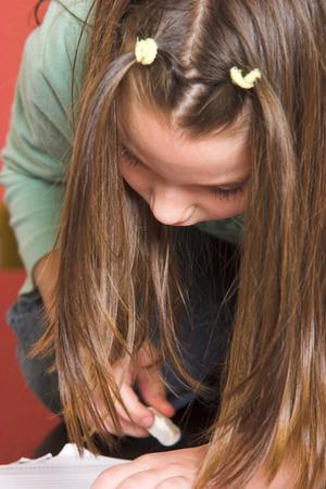Young girl doing school homework Stock Photo - 1431644