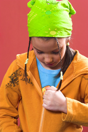 Young girl zipping a sweatshirt Stock Photo