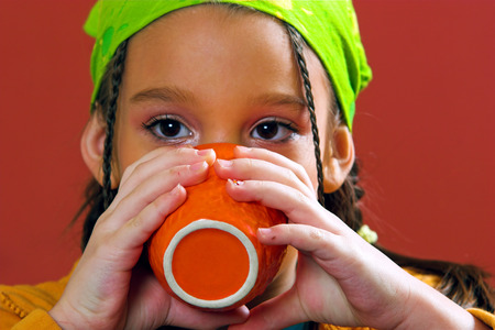 Young girl drinking from a cup
