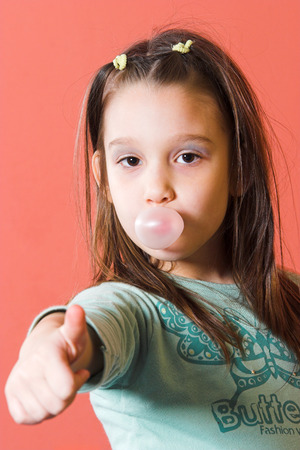 Young girl enjoying a bubble gum