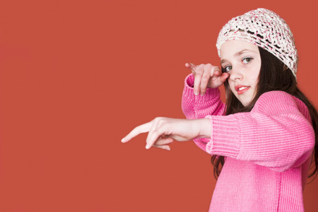 Girl posing as a hip hop star (a lot of copy space) Stock Photo
