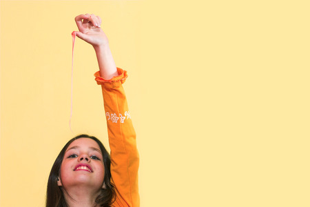Girl stretching a chewing gum from her mouth Stock Photo