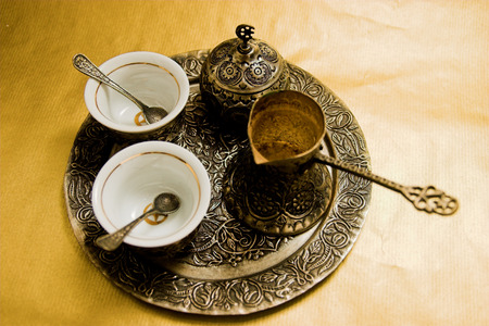 turkey istanbul: Anique Turkish coffee set on gold background