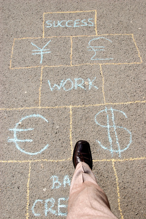 Man playing a business hopscotch photo