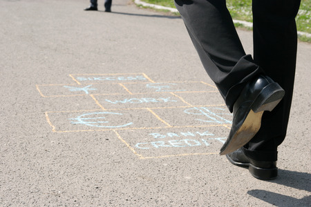 Man playing a business hopscotch