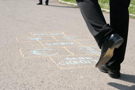 Man playing a business hopscotch