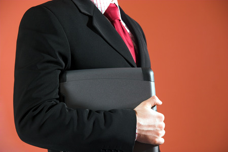 Businessman holding a laptop Stock Photo