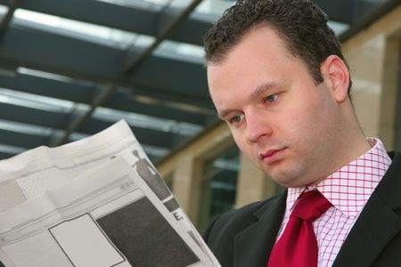 Young businessman reading blank newspapers Stock Photo - 1746719