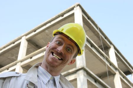 Crazy man with helmet in front of a building construction Stock Photo - 1746696