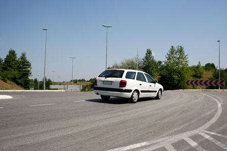 Car passing by and making a turn Stock Photo