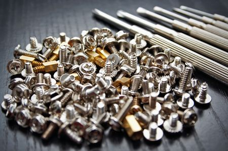Bunch of small screws and precision screwdrivers Stock Photo - 1950799