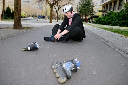 rollerblading: Businessman in a lot of pain from rollerblading