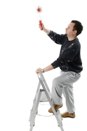 Painter on ladder holding a paint roller Stock Photo