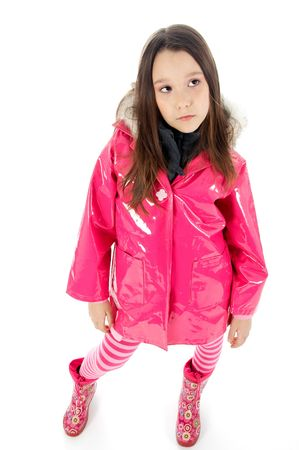 waders: Young girl posing in a pink raincoat