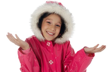 Young girl in a pink raincoat with woolly hood, making an  photo