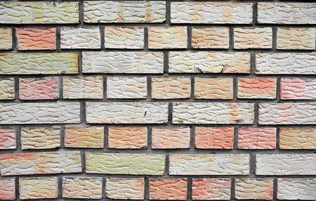 Brick wall texture with yellowred bricks photo