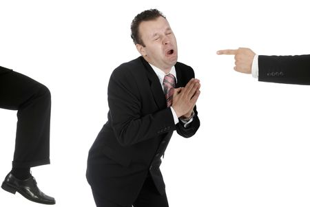 Businessman begging for work as he gets kicked in the ass Stock Photo
