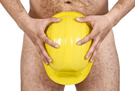 Naked man covering his penis with a hardhat photo