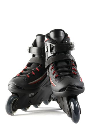 A pair of inline skates on white background with clipping path