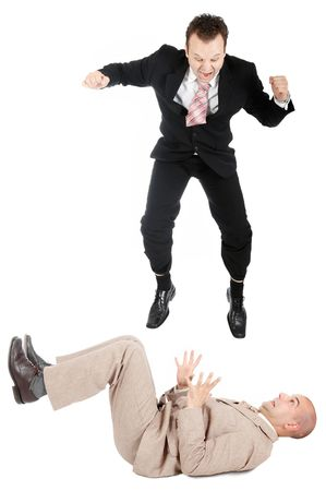to another: One businessman jumping on another businessman