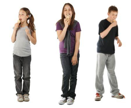 Three kids eating ice cream, isolated on white
