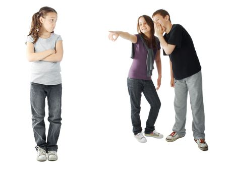 mean: Two kids making fun of a young girl Stock Photo