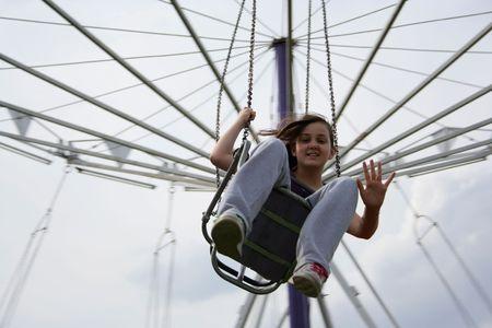 Girl on a merry-go-round photo