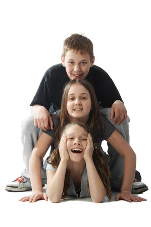 Three happy kids lying on each other