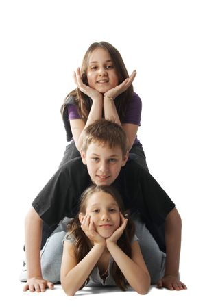 Three happy kids lying on each other photo