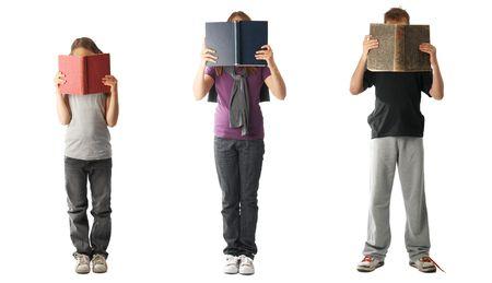 kids reading: Three kids reading books, isolated on white