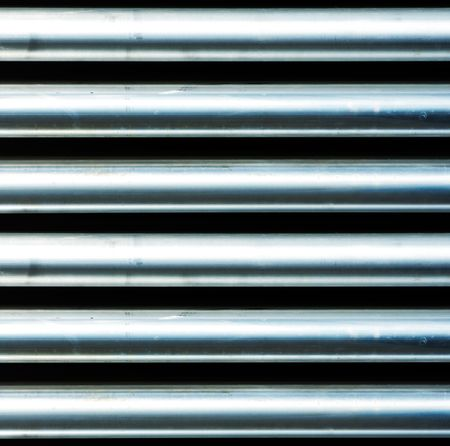 continued: Photo of metal pipes texture that can be continued as a loop