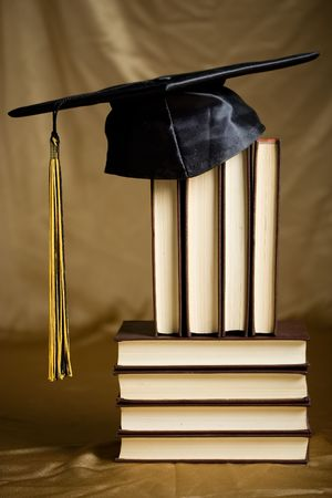 Mortar Board sitting on a pile of books