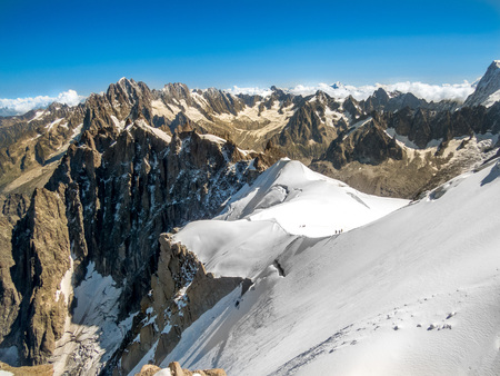 cloud capped: View from top of the Aiguille du Midi, Chamonix, Mont Blanc Stock Photo