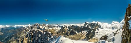 blanc: Chopper over panoramic view of peaks around Mont Blanc