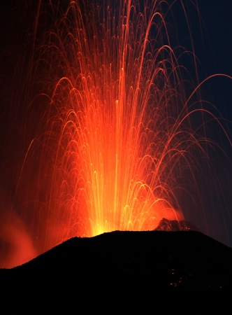 dawn eruption at Stromboli volcano Italy close view photo