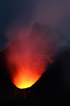 Direct view into a volcano  crater  glowing at night photo