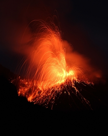 Pretty  night eruption Volcano Stromboli Stock Photo
