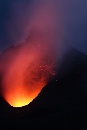 Night view into the glowing crater, Volcano Stromboli Stock Photo