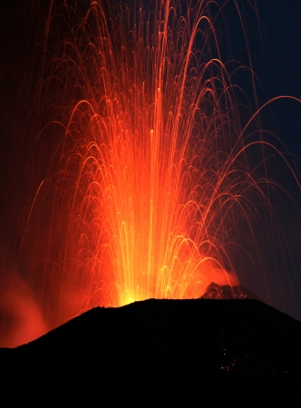 volcano: Strombolian eruption at volcano Stromboli in Italy Stock Photo