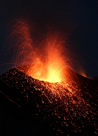 Strombolian eruption at volcano Stromboli in Italy Stock Photo