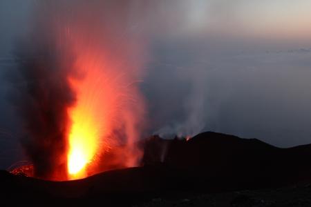 Strombolian eruption at volcano Stromboli in Italy photo