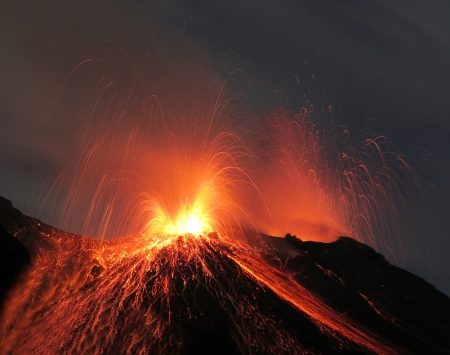 volcanos: Strombolian eruption at volcano Stromboli in Italy Stock Photo