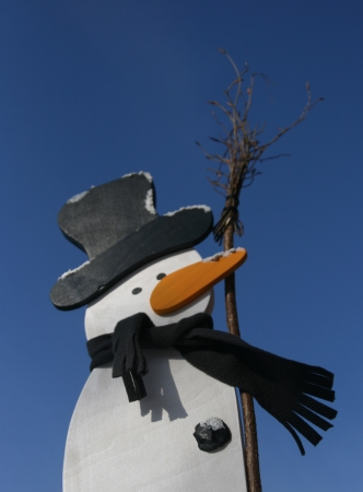 Snowmanscene in the blue sky