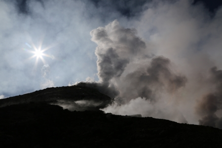 Volcano etna in Sicily with steam emission in the morning sun