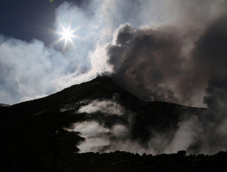 erupt: Volcano etna in Sicily with steam emission in the morning sun