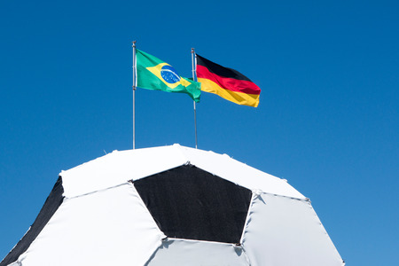 German and Brazilian flag on football World Cup 2014 Stock Photo