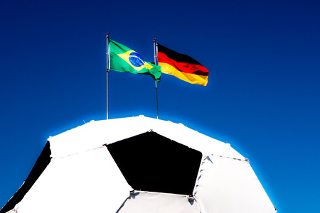German and Brazilian flag on football Stock Photo