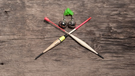 fishing floats: Fishing floats assorted colors. On wooden background Stock Photo